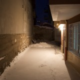 Snowy night alley
